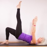 high spine curl with arms extended and single leg extension